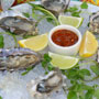 Oysters on a bed of ice with lemon and chili paste