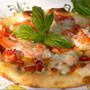 Pizza Margherita with fresh basil