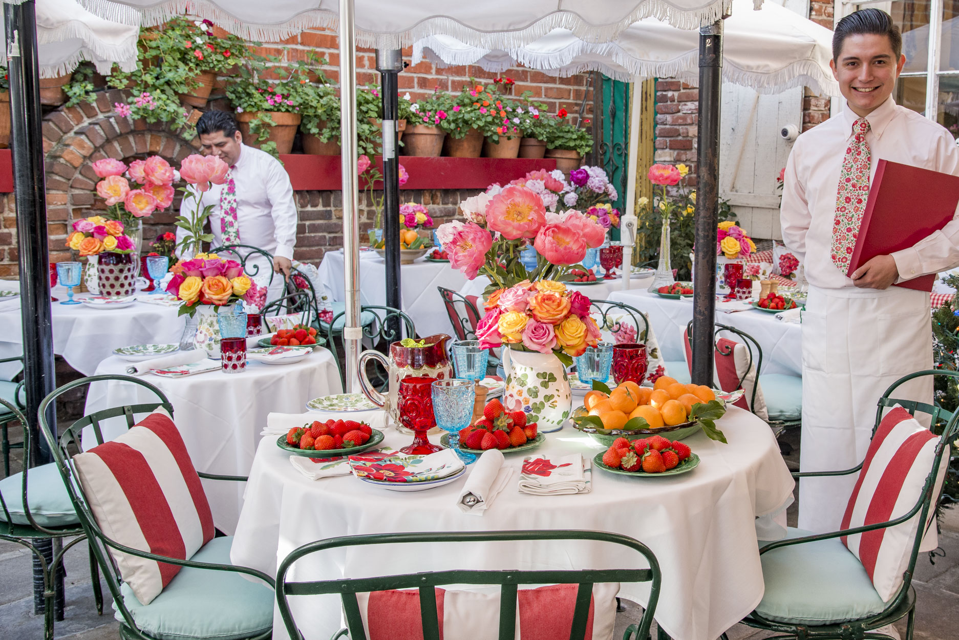 The Ivy Restaurant outdoor patio with french garden chairs, roses and peonies on every table and 