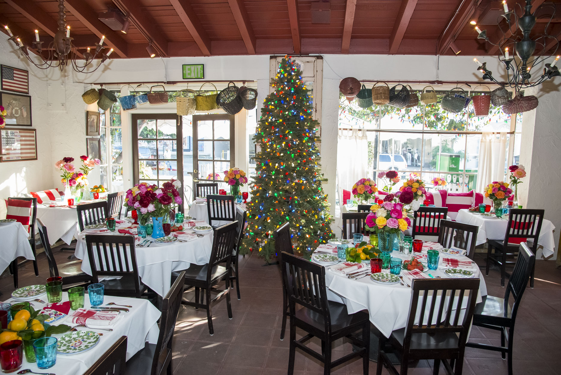 The Ivy Restaurant interior with a Christmas tree, colorful antique basquets hanging over the 