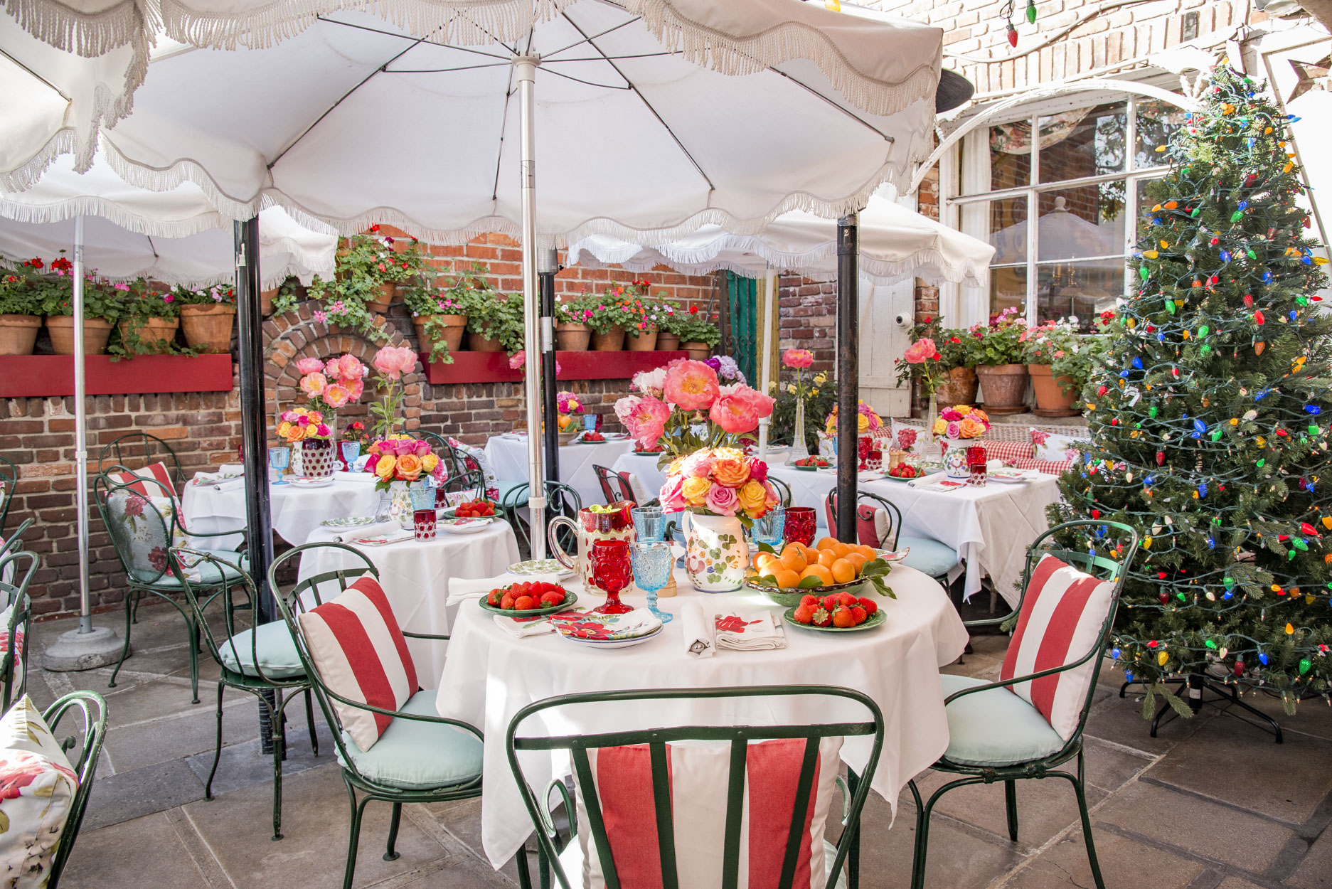 The Ivy Restaurant outdoor patio with french garden chairs, roses and peonies on every 